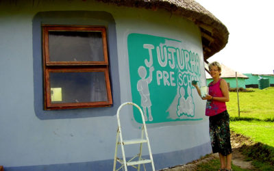Sarah painting Jujurha Pre-School sign. 2015